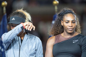 2018 US Open Tennis Tournament- Day Thirteen.  Winner Naomi Osaka of Japan in tears alongside Serena Williams of the United States