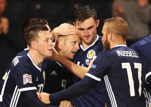GLASGOW, SCOTLAND - SEPTEMBER 10: Steven Naismith of Scotland is congratulated after scoring the opening goal during the UEFA Nations League C group one match between Scotland and Albania at Hampden Park on September 10, 2018 in Glasgow, United Kingdom. (Photo by Ian MacNicol/Getty Images)