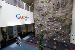 An interior view of office space with an indoor climbing wall at the Googleplex, the corporate headquarters complex of Google, Inc., located in Mountain View, California. (Photo by Brooks Kraft LLC/Corbis via Getty Images)