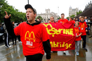Demonstrators participate in a protest over working conditions and the use of zero-hour contracts at British outlets of US burger chain McDonalds, in central London on September 4, 2017.