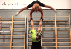 Acrobats demonstrate strength and balance with epic handstand