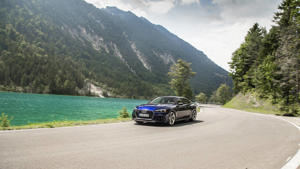 a car parked on the side of a mountain road: 2019 Audi RS5 Sportback