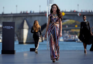 Actor Andie MacDowell presents a creation on a giant catwalk installed on a barge on the Seine River during a public event organized by French cosmetics group L'Oreal as part of Paris Fashion Week, France, September 30, 2018. REUTERS/Stephane Mahe