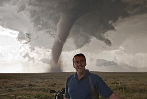 CAMPO, CO MAY 31: Here is a shot of 53 year old Roger Hill in front of one of the prettiest tornadoes of 2010 on May 31, 2010 near Campo, Colorado. If your bored of beach holidays and looking for something different this summer then you may want to think about a trip to America's mid-west. Storm-chasing husband and wife team Roger and Caryn Hill take British tourists on the hunt of their lives following deadly and destructive tornados. Plowing their way through America's 'Tornado Alley' Roger and Caryn drive groups of up to 18 people at a time in three buses and charge up to £230 a day for a ten day tornado chase. Offering their adrenaline inducing 'Silver Lining Tours', Roger, 53 and Caryn, 50, estimate that they have taken almost 1500 people to observe raging tornado's in the American Mid-West since 2000. Taking their paying guests to within 1/4 of mile of some of the swirling 300 mph vertical wind funnels, the husband and wife team have documented awe inspiring incidents of turning twisters and powerful super-cell storms. (Photo by Roger Hill/Barcroft USA / Getty Images)