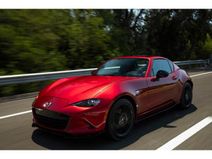 a red car parked on the side of a road: 2019 Mazda MX-5 Miata