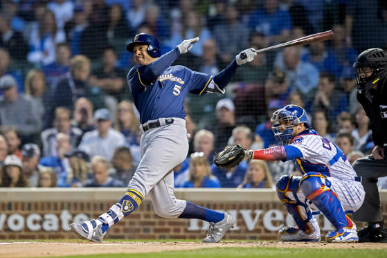 Slide 3 of 17: Sep 10, 2018; Chicago, IL, USA; Milwaukee Brewers second baseman Jonathan Schoop (5) hits a sacrifice RBI during the first inning against the Chicago Cubs at Wrigley Field. Mandatory Credit: Patrick Gorski-USA TODAY Sports - 11221912