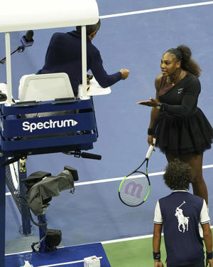 Serena Williams argues with chair umpire during a match against Naomi Osaka, of Japan, during the women's finals of the U.S. Open tennis tournament at the USTA Billie Jean King National Tennis Center on Saturday, Sept. 8, 2018, in New York. (Photo by Greg Allen/Invision/AP)