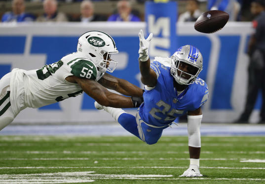 Slide 1 of 17: Detroit Lions running back Theo Riddick (25) reaches for the ball as New York Jets linebacker Kevin Pierre-Louis (56) defends in the first half of an NFL football game in Detroit, Monday, Sept. 10, 2018. (AP Photo/Rick Osentoski)