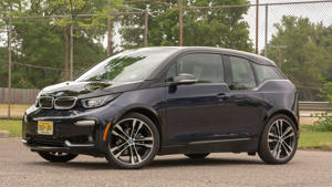 a car parked in a parking lot: 2018 BMW i3s