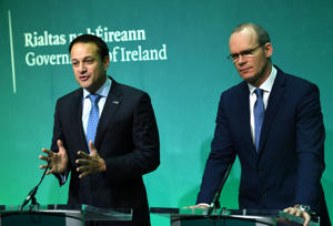 Ireland's Taoiseach Leo Varadkar and Minister for Foreign Affairs and Trade Simon Coveney, hold a press conference in Dublin, Ireland, December 8, 2017. REUTERS/Clodagh Kilcoyne
