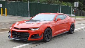 a red car parked in a parking lot: 2019 Chevy Camaro ZL1 1LE Spy Shot