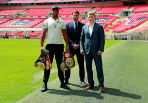 Boxing - Anthony Joshua & Alexander Povetkin Press Conference - London, Britain - July 18, 2018   Anthony Joshua, Promoter Eddie Hearn and Alexander Povetkin pose for a photograph after the press conference   Action Images via Reuters/Andrew Couldridge