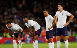 Soccer Football - International Friendly - England v Switzerland - King Power Stadium, Leicester, Britain - September 11, 2018  England's Kyle Walker, Marcus Rashford, Trent Alexander-Arnold and Harry Maguire look on as the prepare to take a free-kick  Action Images via Reuters/Andrew Boyers