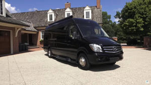 a car parked in front of a house: Mercedes-Benz Sprinter Presidential By Ultimate Toys