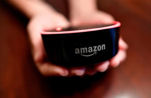 HFM JENNY KAN**A child holds his Amazon Echo Dot, Thursday, Aug. 16, 2018, in Kennesaw, Ga. (AP Photo/Mike Stewart)