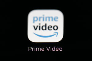 FILE  - This March 19, 2018 file photo shows Amazon's Prime Video streaming app on an iPad in Baltimore. The Premier League broadcasting landscape has been reshaped with Amazon becoming the first internet streaming service to buy live rights in Britain and all overseas revenue no longer being shared equally by clubs. Amazon's Prime Video service has bought the rights for two rounds of live matches each season in Britain a three-year deal from 2019 it was reported on Thursday, June 7, 2018.  (AP Photo/Patrick Semansky, File)