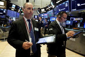 Traders Gordon Charlop, left, and Edward Curran work on the floor of the New York Stock Exchange, Thursday, Sept. 6, 2018. U.S. stocks are little changed at the start of trading as retailers and industrial companies rise and energy and technology companies slip. (AP Photo/Richard Drew)