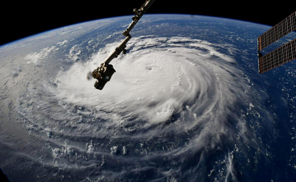 Slide 1 of 30: Hurricane Florence is seen from the International Space Station as it churns in the Atlantic Ocean towards the east coast of the United States, September 10, 2018.  NASA/Handout via REUTERS  ATTENTION EDITORS - THIS IMAGE WAS PROVIDED BY A THIRD PARTY      TPX IMAGES OF THE DAY