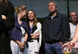 Actress Yulia Peresild, Polina Deripaska, chairperson of the Board of Directors at Forward Media Group Publishing House, and Russian businessman Roman Abramovich (L-R)   (Photo by Vyacheslav Prokofyev\TASS via Getty Images)
