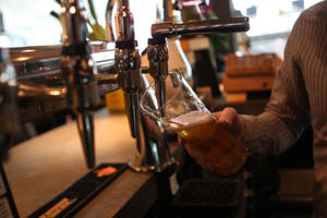 A bar person pouring a pint of Lager.   (Photo by Steve Parsons/PA Images via Getty Images)