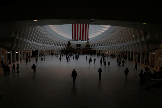 Slide 2 of 28: An American flag hangs inside the Oculus transportation hub at the World Trade Center in lower Manhattan on the 17th anniversary of the September 11, 2001 attacks in New York, U.S., September 11, 2018. REUTERS/Brendan McDermid