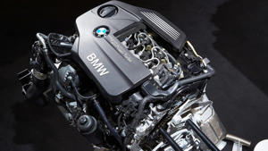 a black motorcycle: BMW TwinPower Turbo 4-cylinder diesel engine.