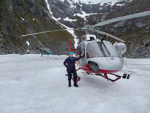 Caroline after landing on Herbert Glacier in a helicopter. The journey there took her over jagged peaks