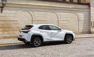 a car parked in front of a brick building: The 2019 Lexus UX Is More Than a Dressed-Up Hatchback