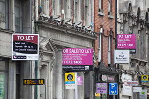 Dublin, Ireland - August 19, 2012: A series of rent/sales signs on several buildings in one of Dublin's busiest streets show the remaints of the financial crisis in the country. After decades of strong growth, Ireland's real estate market broke down in the financial crisis and the country and its banks had to be bailed out by the EU and IMF.