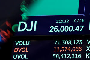 A screen above the floor of the New York Stock Exchange shows the Dow Jones industrial average as it hits 26,000, Monday, Aug. 27, 2018. Stocks are opening broadly higher on Wall Street, extending the market's gains from last week. (AP Photo/Richard Drew)