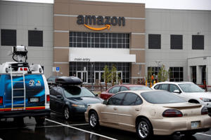 The Amazon fulfillment center Thursday, May 3, 2018, in Aurora, Colo. More than 1,000 full-time associates work in the Aurora facility, which opened in September 2017, and is one of more than 100 such fulfillment centers scattered across North America. (AP Photo/David Zalubowski)