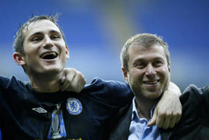 Chelsea's Frank Lampard (L) and owner Roman Abramovich celebrate after the Barclays Premiership match against Bolton Wanderers. Chelsea claimed the title after their 2-0 win.   (Photo by Nick Potts - PA Images/PA Images via Getty Images)