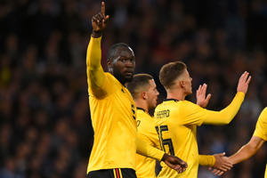 Belgium's striker Romelu Lukaku (L) celebrates with teammates after scoring the opening goal of the International friendly football match between Scotland and Belgium at Hampden Park in Glasgow, Scotland on September 7, 2018.