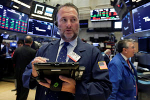 Trader Jonathan Corpina works on the floor of the New York Stock Exchange, Thursday, Sept. 6, 2018. U.S. stocks are little changed at the start of trading as retailers and industrial companies rise and energy and technology companies slip. (AP Photo/Richard Drew)