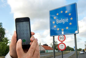 A man uses his mobile phone in Boeschepe at the Franco-Belgian border