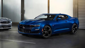 a blue car parked in front of a building: 2019 Chevrolet Camaro SS