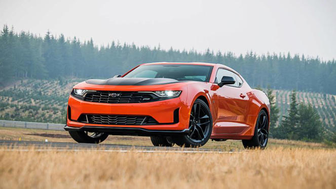 a car parked in the grass: 2019 Chevrolet Camaro Turbo 1LE