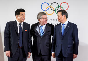 International Olympic Committee (IOC) President Thomas Bach (C) poses with North Korea's Sports Minister and Olympic Committee president Kim Il Guk (L) and South Korean Minister of Culture, Sports and Tourism Do Jong-hwan at the IOC headquarters on January 20, 2018 in Pully near Lausanne.