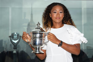 Naomi Osaka of Japan poses with the championship trophy at the Top of the Rock Observatory the day after winning the Women's Singles finals match against Serena Williams at the 2018 U.S. Open in the Manhattan borough of New York City, U.S., September 9, 2018. REUTERS/Caitlin Ochs