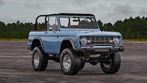 a truck driving down a dirt road: 1973 Ford Bronco Feature