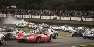 a car parked in a parking lot: Goodwood Revival is the best vintage vehicle event in the world.