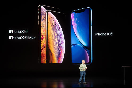 Slide 1 of 10: Phil Schiller, Apple senior vice president, discusses his company's iPhone line-up during an event on September 12, 2018, in Cupertino, California. - New iPhones set to be unveiled Wednesday offer Apple a chance for fresh momentum in a sputtering smartphone market as the California tech giant moves into new products and services to diversify.Apple was expected to introduce three new iPhone models at its media event at its Cupertino campus, notably seeking to strengthen its position in the premium smartphone market a year after launching its $1,000 iPhone X. (Photo by NOAH BERGER / AFP)        (Photo credit should read NOAH BERGER/AFP/Getty Images)