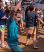 Boy steals the show on cruise ship dance party