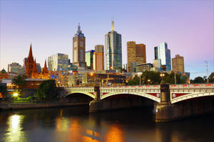 City skyline of Melbourne and the Princes Bridge over the Yarra River at sunset, Melbourne, Victoria, Australia
