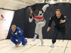 "In this Wednesday, Sept. 12, 2018 photo provided by Mumm/Novespace Jamaican athlete Usain Bolt, center, attempts to run, during a zero-gravity flight over France, courtesy of a champagne producer, near Vatry, eastern France. Taking a break from his efforts to become a professional soccer player, Bolt said he felt like a ""kid in a candy store"" after spending about four minutes floating and joking around in near-weightless conditions."