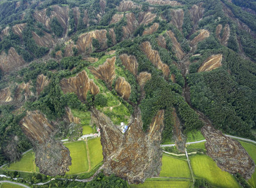Slide 1 of 42: Landslides caused by an earthquake are seen in Atsuma town, Hokkaido, northern Japan, on Sept. 7.