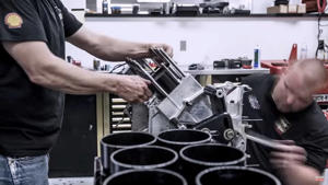 a man standing in front of a computer: Top Fuel Dragster Engine Rebuild