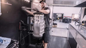 a man standing in a room: Top Fuel Dragster Engine Rebuild