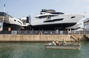 SOUTHAMPTON, ENGLAND - SEPTEMBER 15:  A boat passes as last minute preparations and cleaning are made to luxury yachts that are being displayed on the Sunseeker stand at the 2016 Southampton Boat Show which opens its doors to the public tomorrow on September 15, 2016 in Southampton, England. The 10-day show, now in its 48th year, features more than 1,000 boats and 500 exhibitors from all over the world and is one of the biggest on-water boat shows in Europe.  (Photo by Matt Cardy/Getty Images)