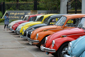 Vintage Volkswagen Beetle cars are parked in a row during a rally held as part of the 23rd anniversary of 'World Wide VW Beetle Day', in Bangalore on June 24, 2018. - 'World Wide VW Beetle Day' or 'Drive your VW to work day' is celebrated every year on June 22 by enthusiasts of the Volkswagen Beetle all over the world to commemorate the German car model. (Photo by MANJUNATH KIRAN / AFP)        (Photo credit should read MANJUNATH KIRAN/AFP/Getty Images)